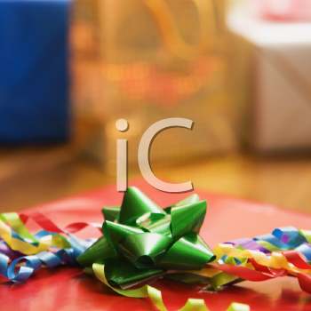 Royalty Free Photo of Presents Wrapped and Decorated With Bows on a Table