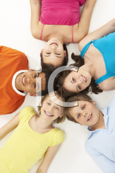 Royalty Free Photo of a Group of Children Lying on the Floor