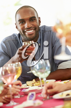 Young Man Relaxing At Dinner Party