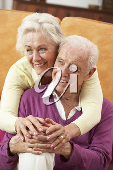 Romantic Senior Couple Relaxing At Home