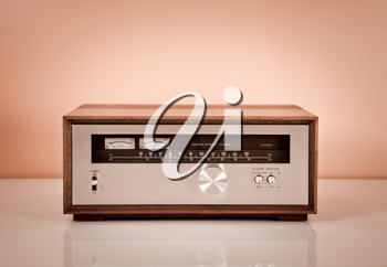 Royalty Free Photo of a Vintage Stereo Tuner in a Wooden Cabinet