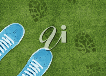 Royalty Free Photo of Shoe Prints with a Pair of Blue Shoes