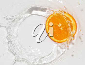 orange in water on white background