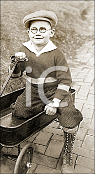 Royalty Free Photo of a Boy and a Wagon