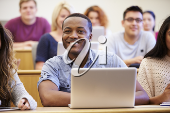 Male University Student Using Laptop In Lecture