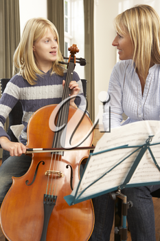 Girl playing cello in music lesson