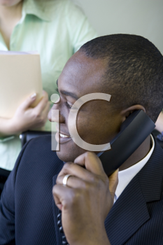 Royalty Free Photo of a Black Businessman on the Telephone